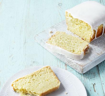 A vegan lemon cake loaf cut into slices