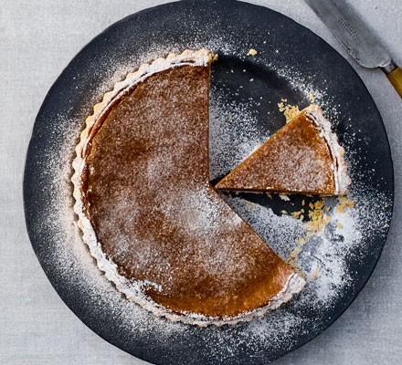 Vegan pumpkin pie on plate with slice cut