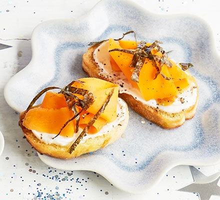 Vegan 'smoked salmon' toasts served on a decorative plate