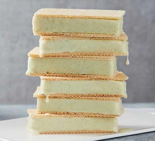 Tower of vanilla ice cream in wafer sandwiches