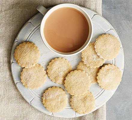 Vegan shortbread served on a plate with a cup of tea
