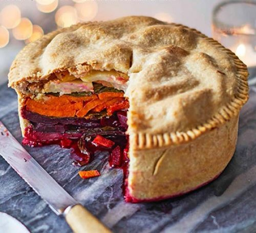 Vegetable filled pie with a colourful veggie filling