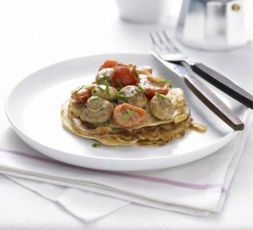 Mushrooms and tomatoes on pancakes