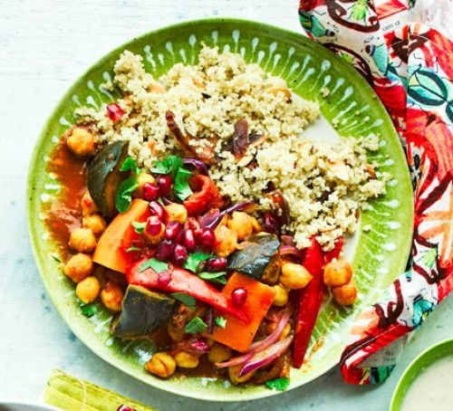 Vegetable tagine with couscous on a green plate