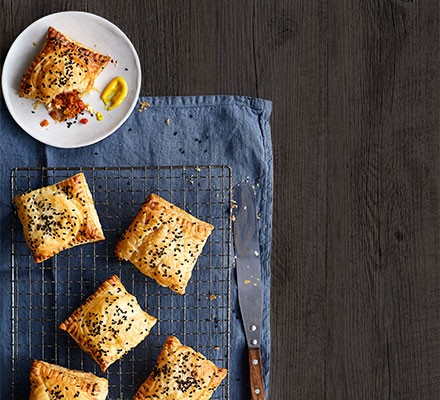 Spiced 'chorizo' pastry slices on a wire tray