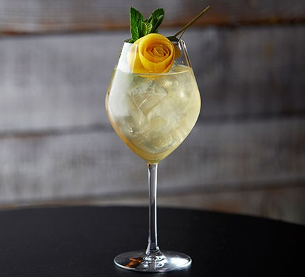 Verbena Spritz served in a wine glass