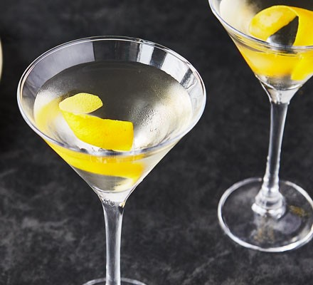 Martini with lemon peel in glass