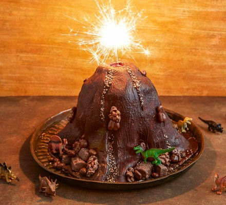 Chocolate volcano cake with sparkler on tray