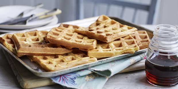 Pile of waffles with maple syrup