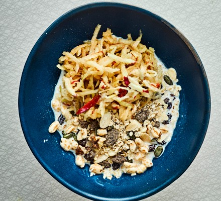 Muesli with grated apple in bowl
