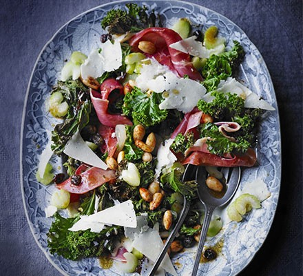 Warm kale salad with almonds & Serrano ham