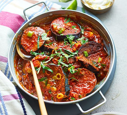 West Indian spiced aubergine curry served in a pan