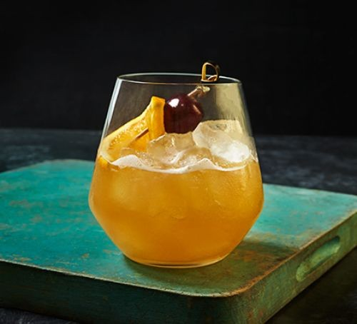 Whiskey cocktail with cherry garnish