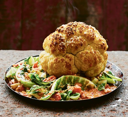 Roasted cauliflower with cabbage and sauce on plate