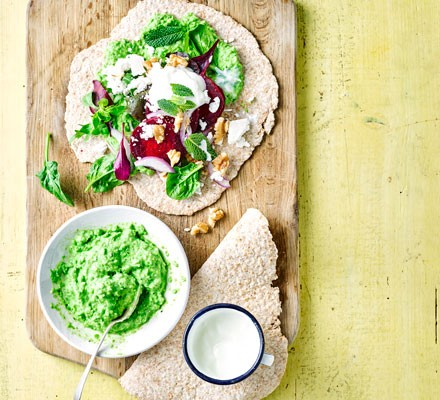 Healthy wholemeal wraps topped with pea hummus, vegetables and feta