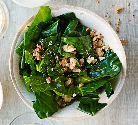 Wilted spring greens in nut oil