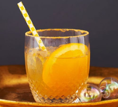 Whiskey sour with orange and straw