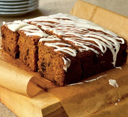 Slices of yummy scrummy carrot cake on brown baking paper