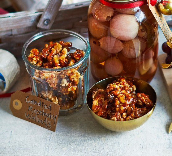 Candied rosemary walnuts presented in a jar
