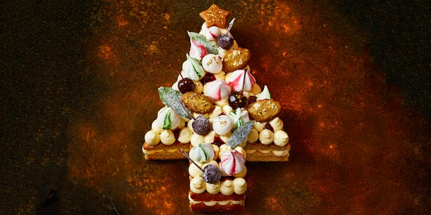 Cake in Christmas tree shape topped with meringues