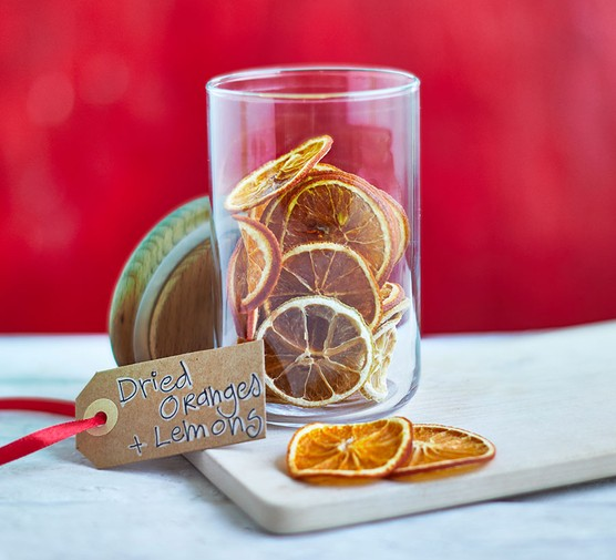 Dried orange and lemon slices in a jar