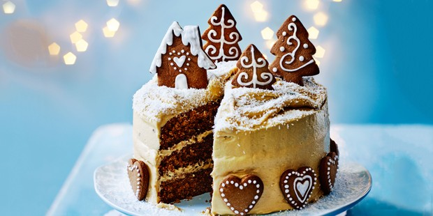 Gingerbread cake topped with marzipan and gingerbread biscuits