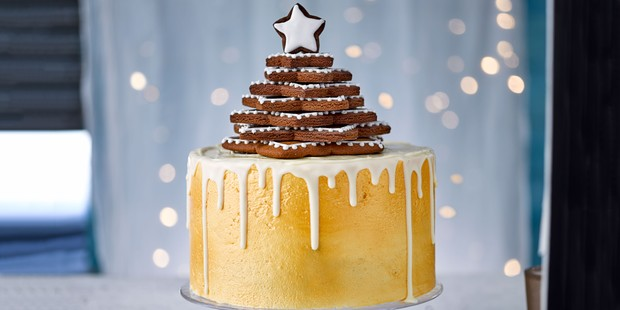 Gold-sprayed cake with white chocolate dip and gingerbread star topping
