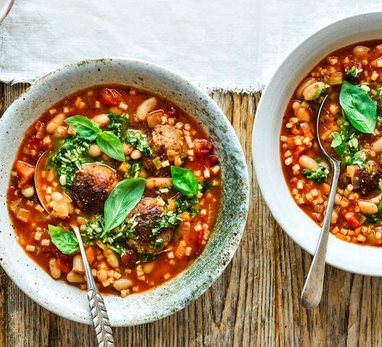 Meatball minestrone with pesto served in bowls