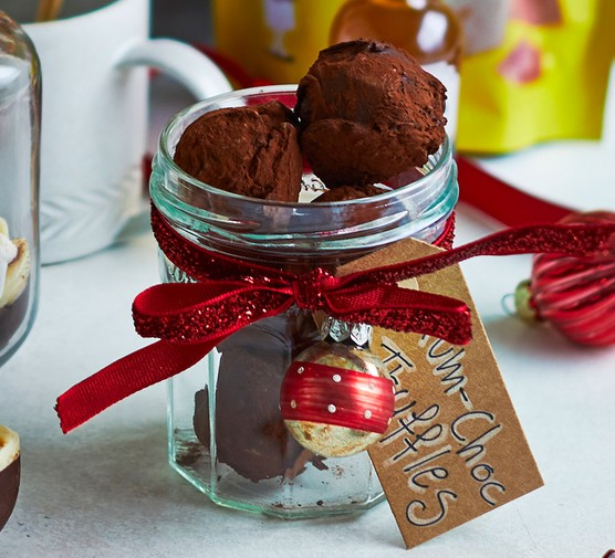 Rum truffles presented in a jar with a gift label