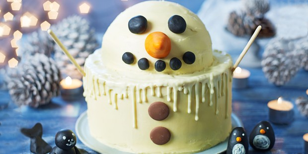 White chocolate cake in snowman shape and design