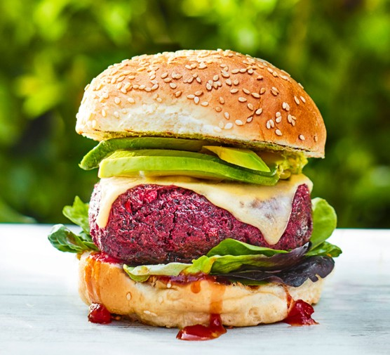 Burger with beetroot patty and vegetable filling