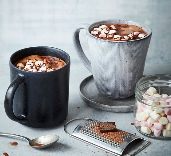 Two mugs of vegan hot chocolate