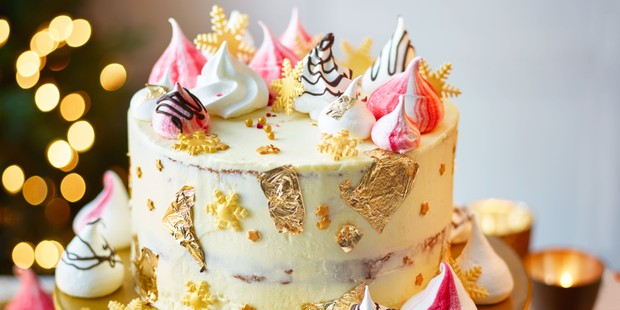White chocolate cake topped with coloured meringues and fold leaf decorations