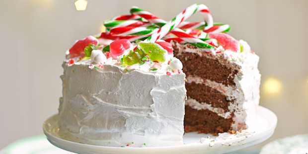 Chocolate cake with white buttercream frosting and candy topping