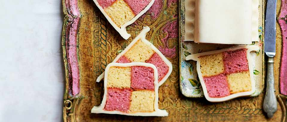 Slices of Battenberg cake on a board