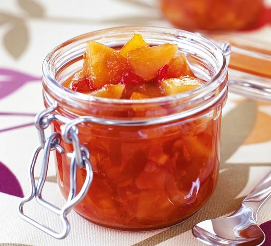 A glass pot of apricot chutney