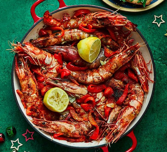 Baked garlic prawns with roasted peppers & gremolata toasts in a large pot