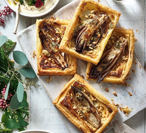 Four balsamic chicory, pine nut and blue cheese tartlets