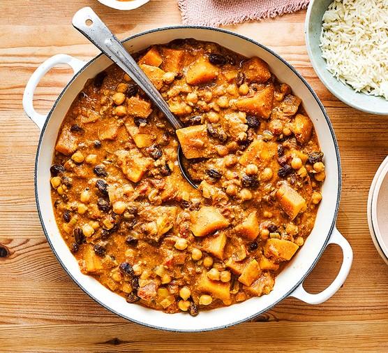 Cashew butternut squash curry served in a casserole dish