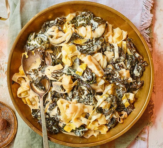 Slow cooker cheesy creamed greens in a bowl
