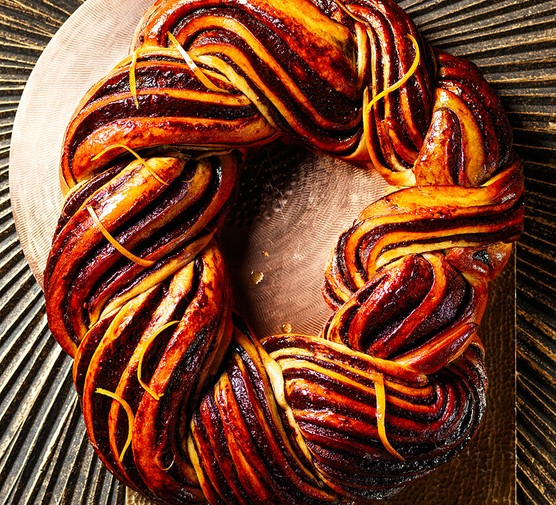 Chocolate orange babka plaited into a festive wreath shape