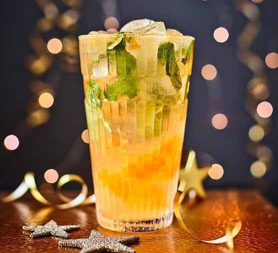 Clementine mock mojito served in a tall glass garnished with mint