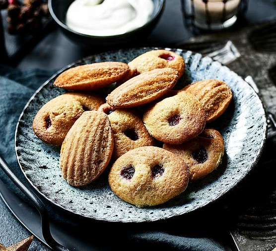 Cranberry and orange madeleines served on a plate
