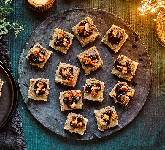 Creamy vegan mushroom pâté with candied walnuts canapes served on a platter