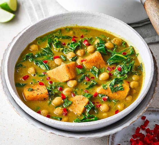 Curried kale and chickpea soup in a bowl