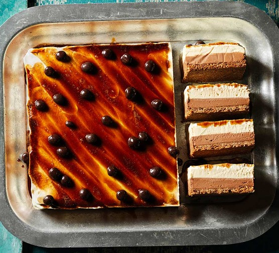 Espresso martini cheesecake garnished with coffee beans