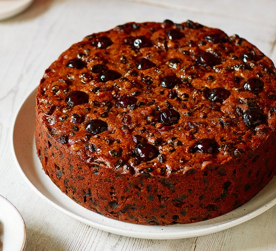 One extra-fruity Christmas cake on a white plate