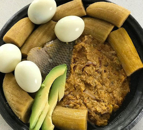 A serving of garden eggs stew with boiled green plantain