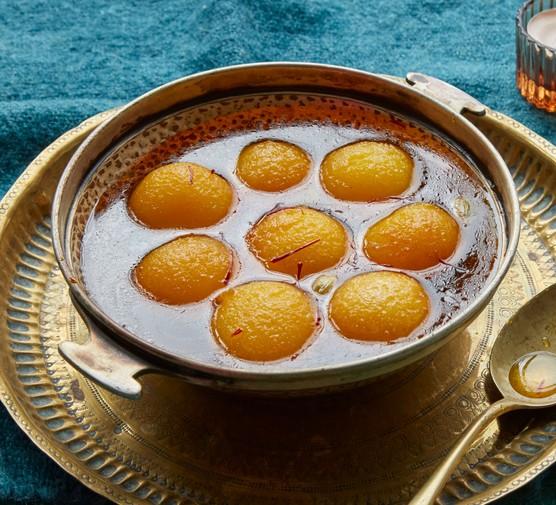 Gulab Jamun in syrup in bowl