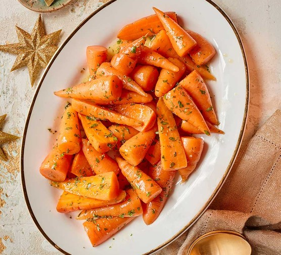 Microwave honey and fennel-glazed carrots on an oval plate